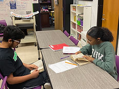 Two students reading.