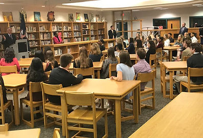 Students listening to International Panel