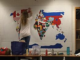 Girl working on global map.