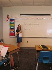 Girl teaching class.