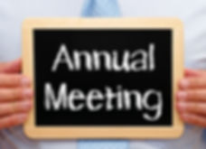 Annual Meeting - Businessman holding cha