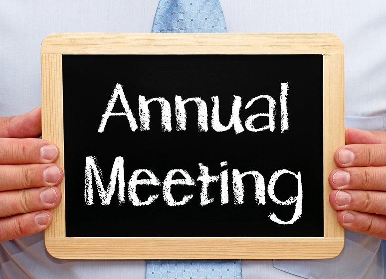 Annual Meeting - Businessman holding cha