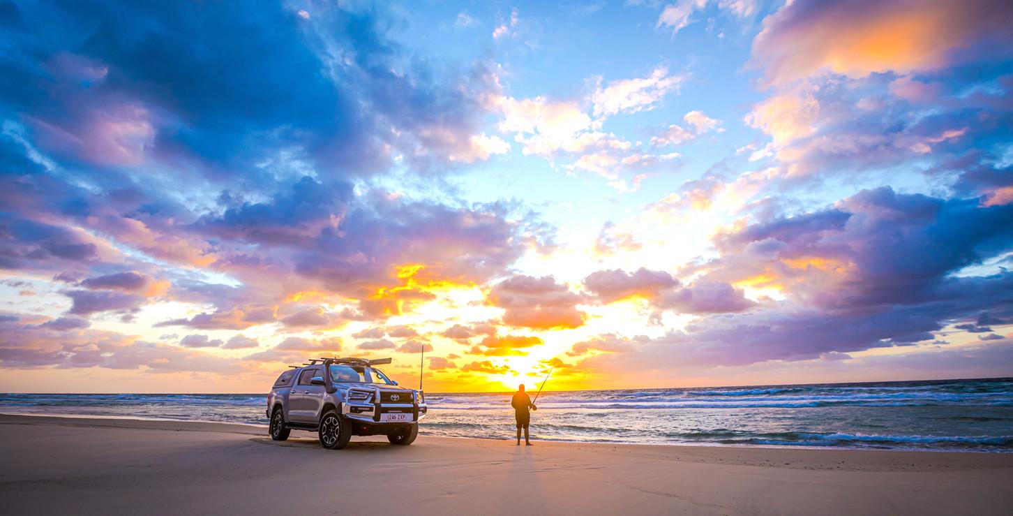 Toyota Hilux - beach sunrise - image Glen Gall ©️