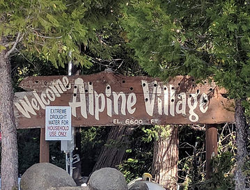 Welcome to Alpine Village Sign