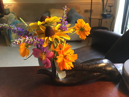 Flowers in the Across Counseling office