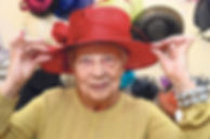 Elderly lady trying on a hat