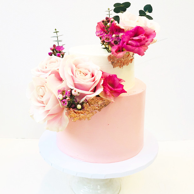 Two Tier Pink and White Cake