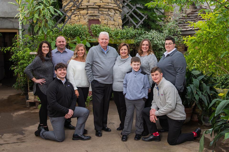 large family portrait at the arboretum
