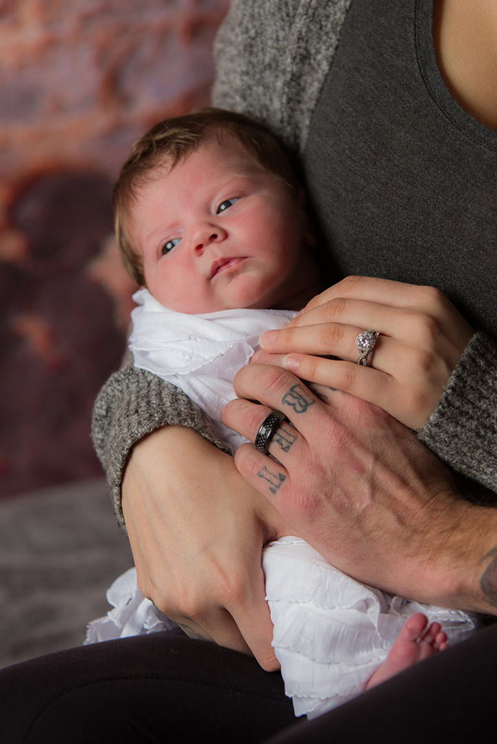 newborn and wedding rings