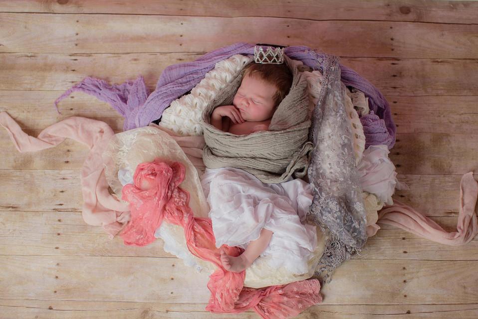 Newborn with a crown