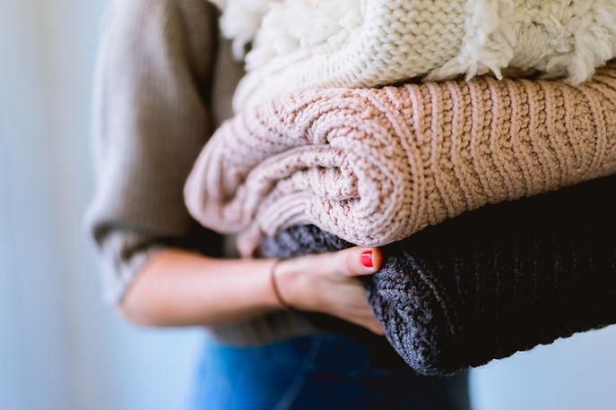 Куча свитеров