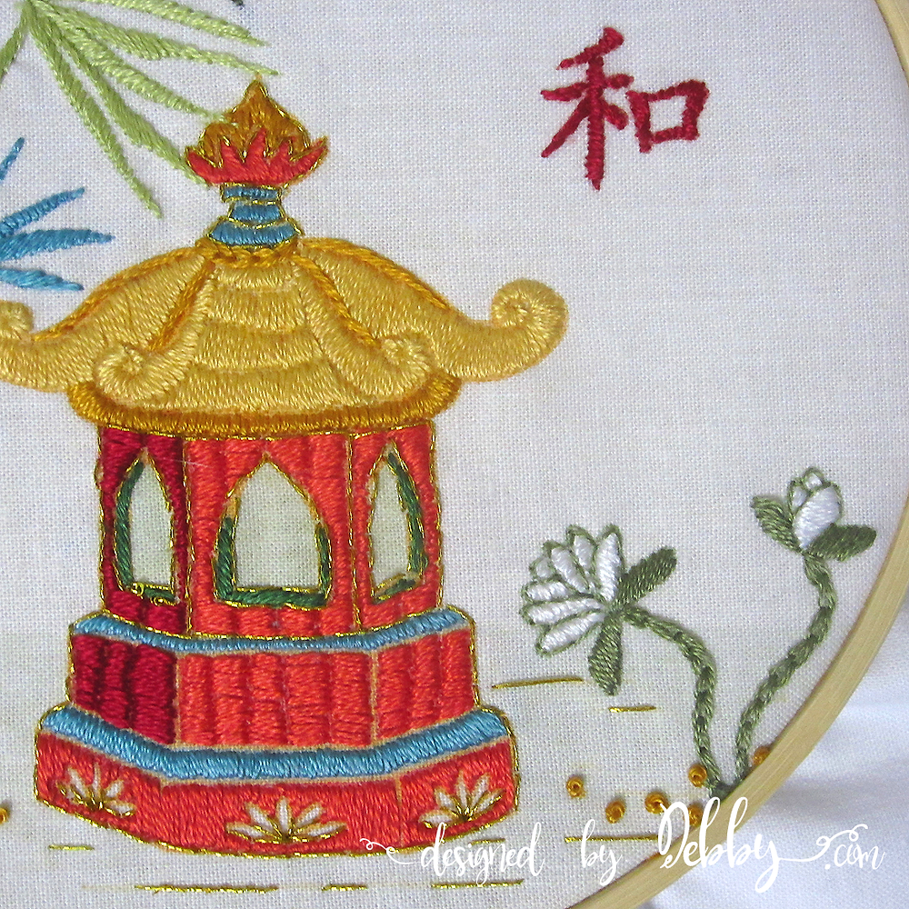 Pagoda of peace embroidery design in hoop.