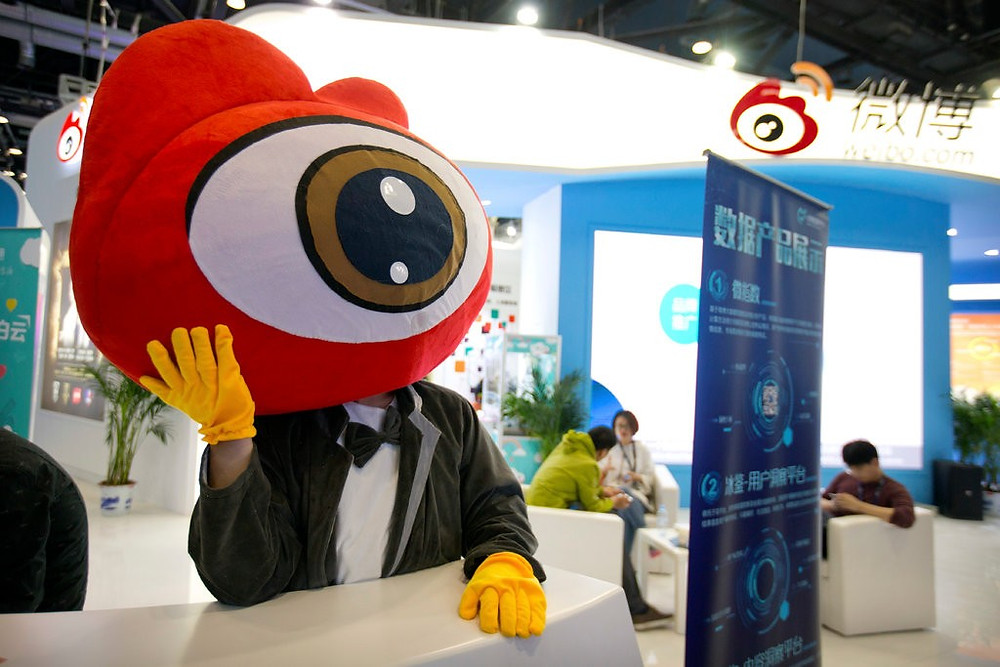 A worker in costume waiting for visitors at a booth for the Chinese microblogging website Sina Weibo at the Global Mobile Internet Conference last year in Beijing. The site has 430 million active users a month.CreditCreditMark Schiefelbein/Associated Press