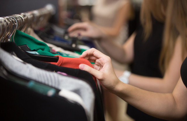 Shopping for apparel.  Shutterstock / fizkes. Photo source from WWD.