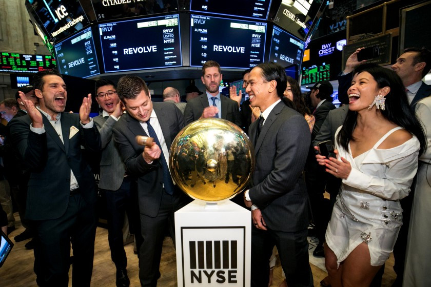 Revolve Group co-CEOs Mike Karanikolas, left, and Michael Mente, right, ring the opening bell at the NYSE on June 7. At far right is Chief Brand Officer Raissa Gerona.(Courtney Crow/NYSE)