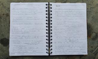 caderno de anotação das conversas com os clientes