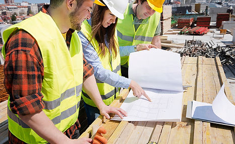 looking-at-building-plans-men-and-woman.