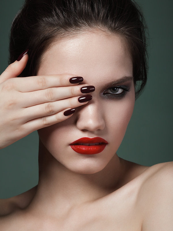 woman holding hand over one eye to view nails tpca