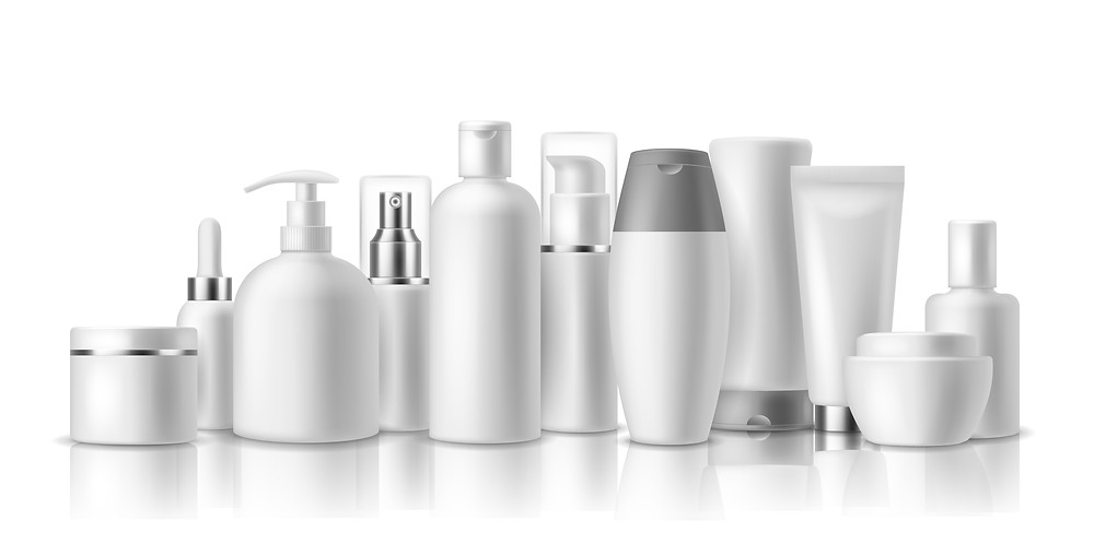 White and silver cosmetic bottles without label.