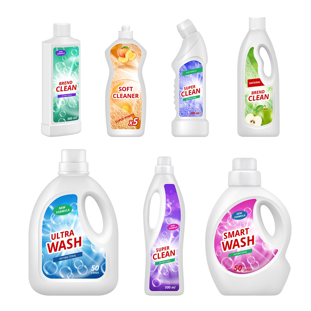 Household cleaning detergents in bottles.