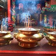 Incense sticks in the pot inside Guan Di