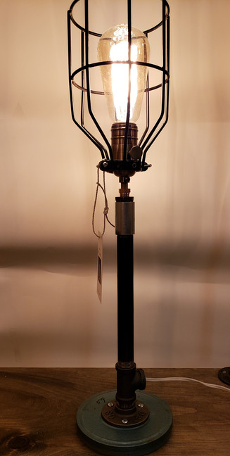 Piped candlestick/movie reel lamp
