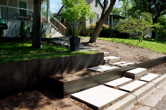 OES | Steel Retaining wall and pavers