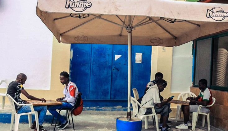 African migrants were playing chess outside of a bar located at Marsa.