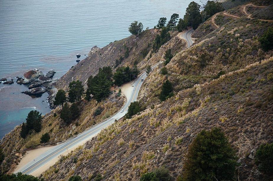 road on autumn mountain over sea