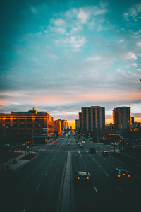 city sunset seen from road