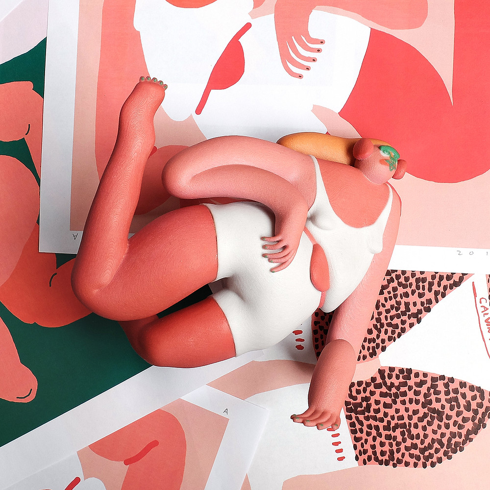 Sculpture of woman surrounded by illustrations by Amber Vittoria