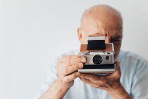 old man with old camera