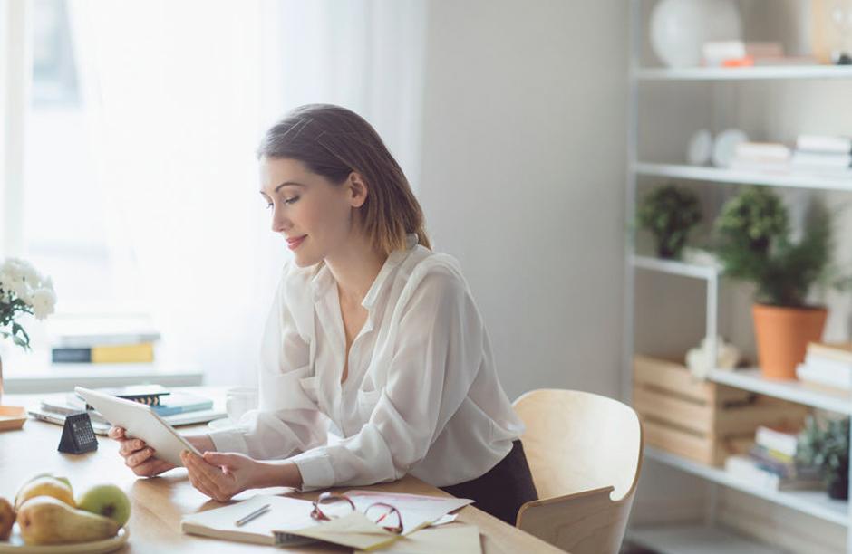 woman reading on ipad, tablet