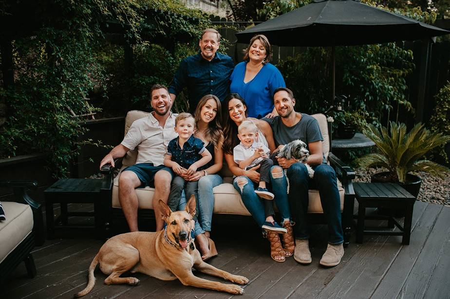 family portait with pet dogs