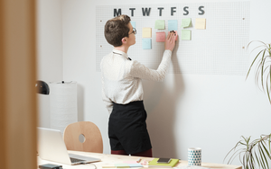 Woman scheduling her time with post-its