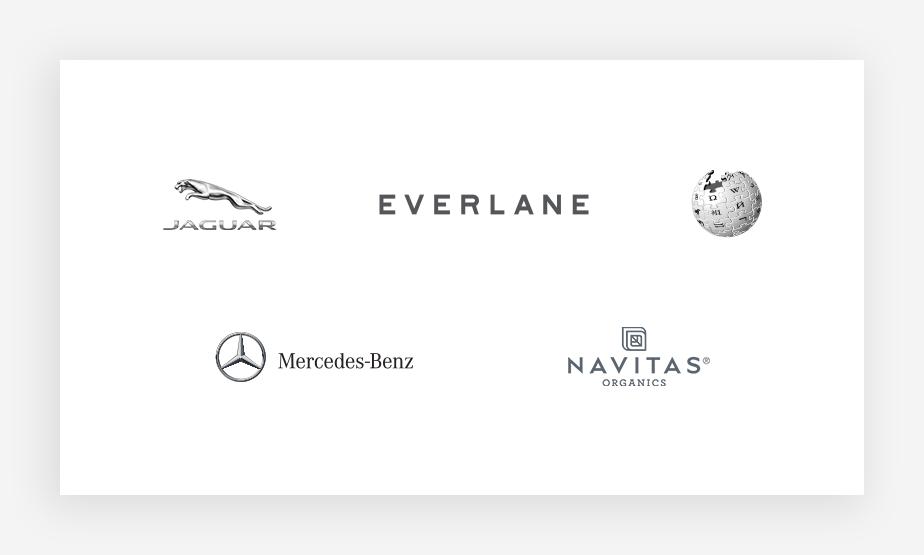 Exemplos de logos em cinza: Jaguar, Everlane, Wikipedia, Mercedes-Benz e Navitas Organics.