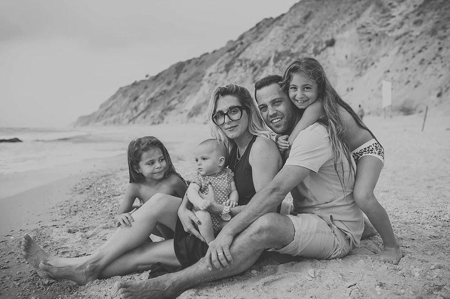 black and white family portrait at the beach