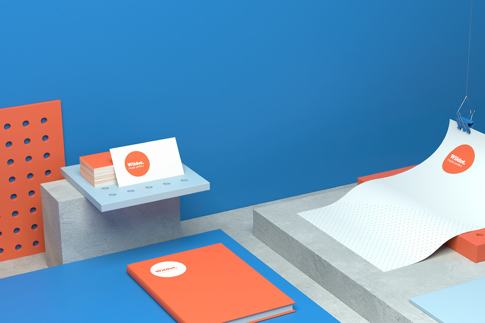 Branding and visual identity design on notebook and business cards