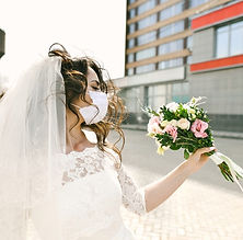 a-bride-wears-dress-and-face-mask_edited