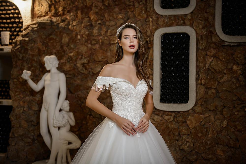 Off shoulder wedding dress from Poshfair Bridal in Ottawa