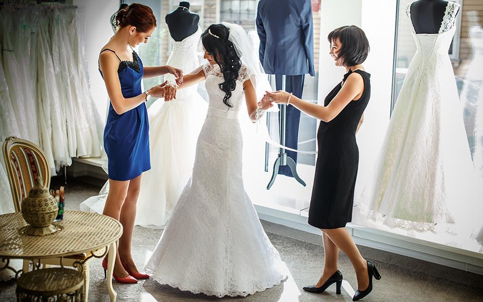 Assisting with wedding dress at wedding store ottawa