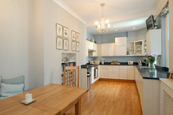 Kitchen with Banquette Style Dining Area