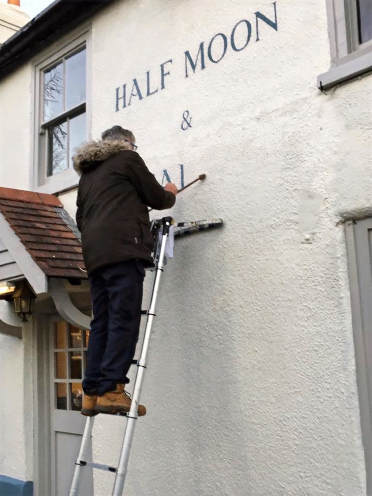 Sign Writing on Newly Painted walls