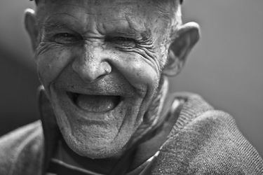 grayscale-photo-of-laughing-old-man-1567