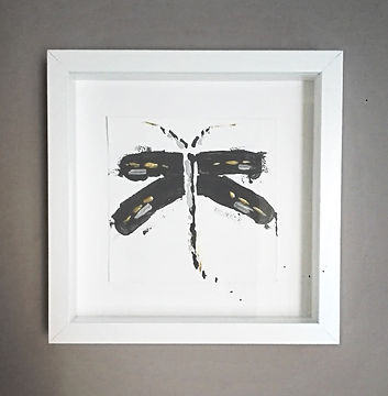 Small grey and gold dragonfly painting on paper, in white frame. simple and abstract painting of dragonfly