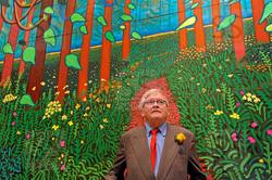 Mr. Hockney in front of his work