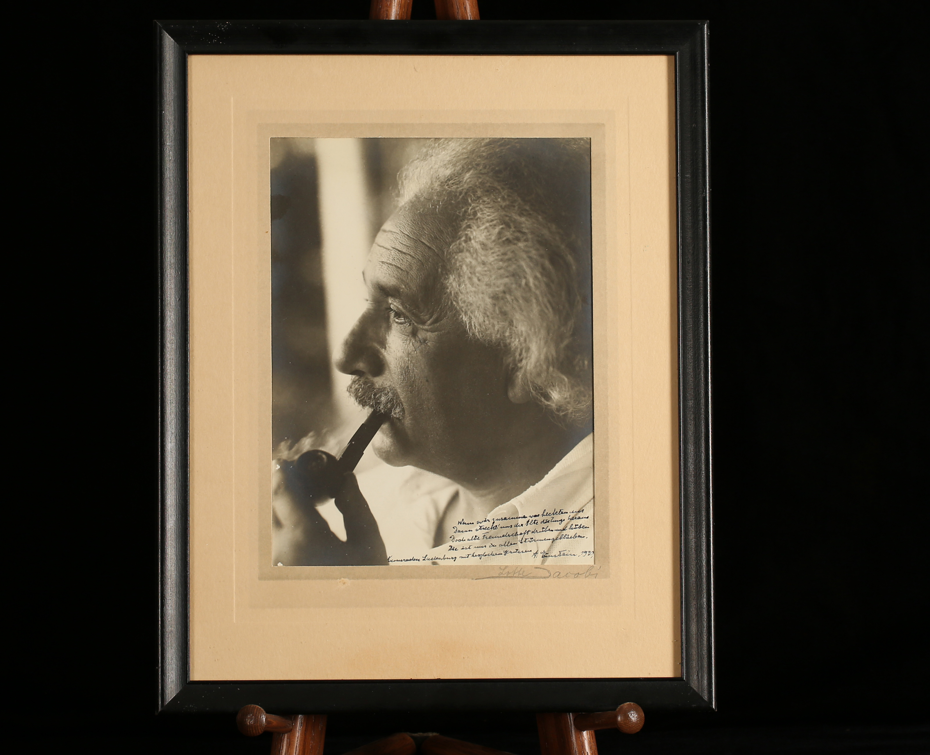 Sepia photograph of Einstein smoking a p
