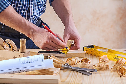 Man with carpenters tools construction c