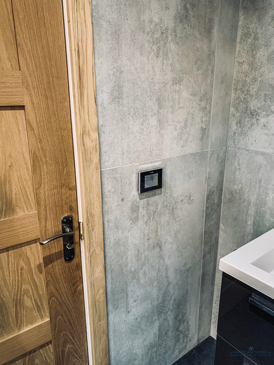 We love the industrial look these large format tiles bring to the bathroom.