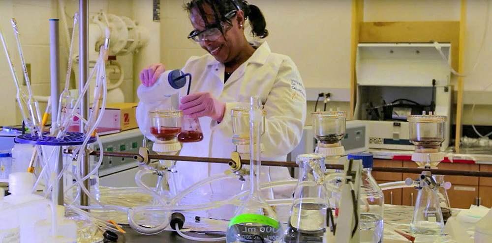 Dr. Asmeret Asefaw Berhe performing an experiment in a laboratory.